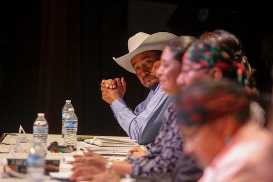 Navajo Nation Council Delegate Tom Chee sits with other Navajo Nation presidential candidates Monday during a forum at the Phil L. Thomas Performing Arts Center in Shiprock.