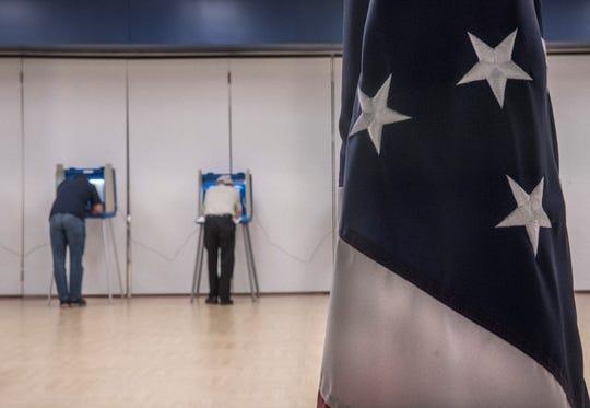 Voters in the 4th precinct at Farmington High School.