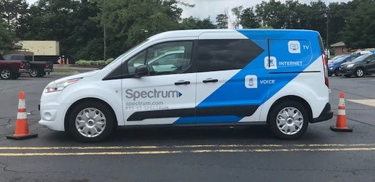 A Spectrum vehicle in the parking lot of the Livonia facility.