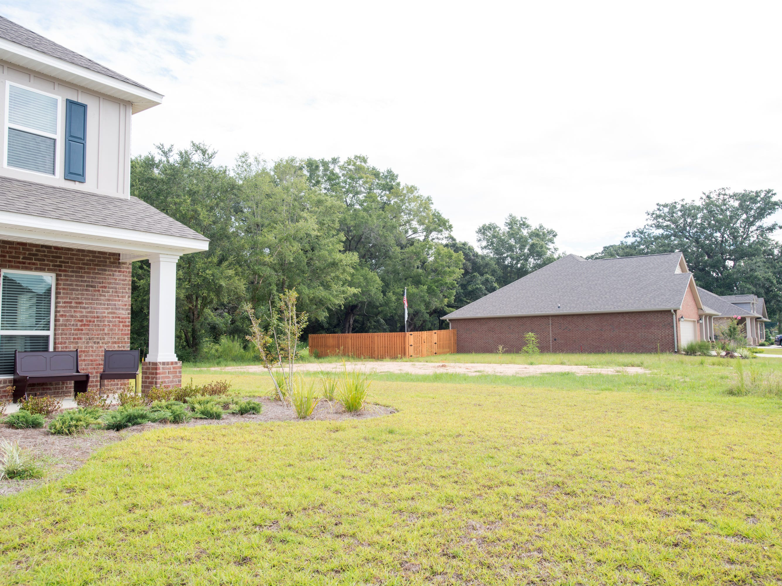 An empty lot between two houses remains undeveloped in the new subdivision of Heritage Estates in Pace's District 1 on Tuesday, August 7, 2018.