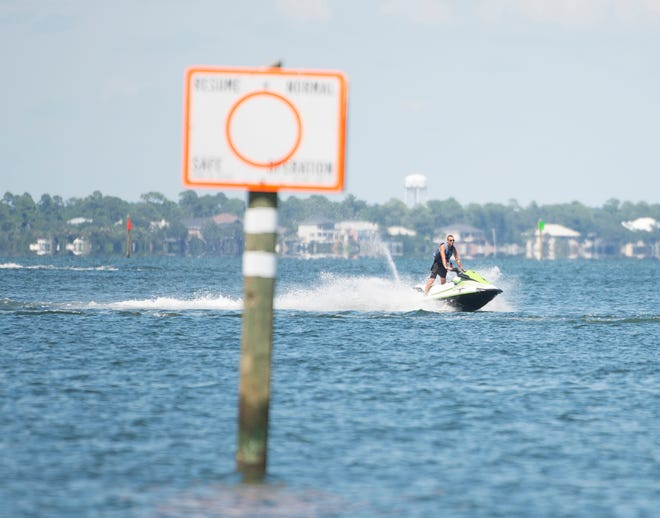 A person rides a waverunner off Pensacola Beach on Tuesday, August 7, 2018.