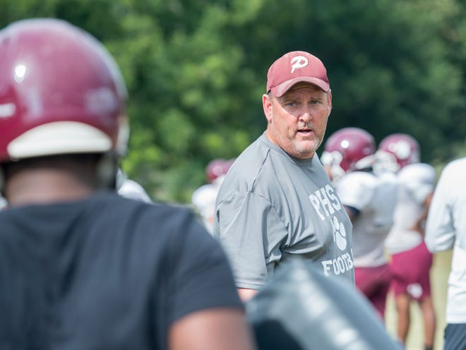 Head coach Mike Mincy instructs players during football practice at Pensacola High School on Friday, August 3, 2018.