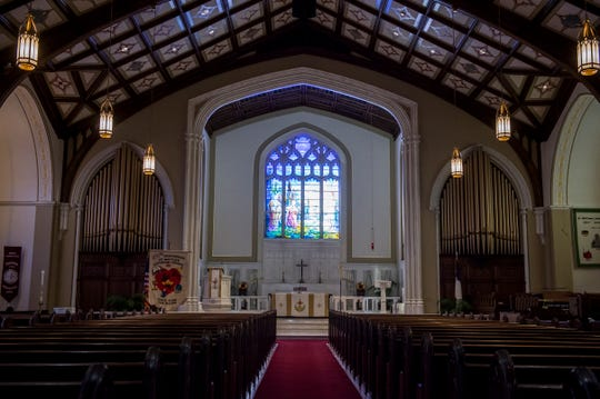 """The front of the nave of St. Matthew Lutheran Church features """"Resurrection Morn,"""" a stained glass window created in 1928 by Charles Mente of Tiffany Studios in New York City."""