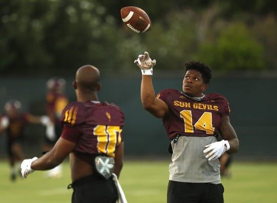 ASU's Ryan Jenkins (14) tosses a ball to teammate Kyle Williams (10) during a practice at Kajikawa Football Practice Fields in Tempe, Ariz. on Aug. 6, 2018.