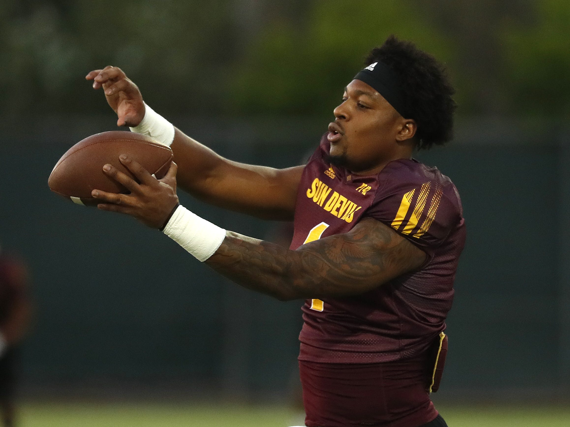 ASU's N'Keal Harry (1) makes a one-handed juggling catch during a practice at Kajikawa Football Practice Fields in Tempe, Ariz. on Aug. 6, 2018.