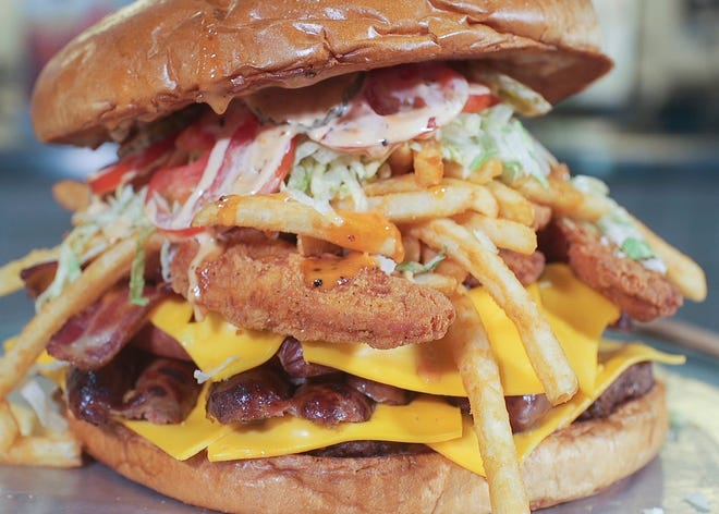 The Arizona Cardinals have unveiled several new food items for the 2018 NFL season, including a seven-pound Gridiron Burger.