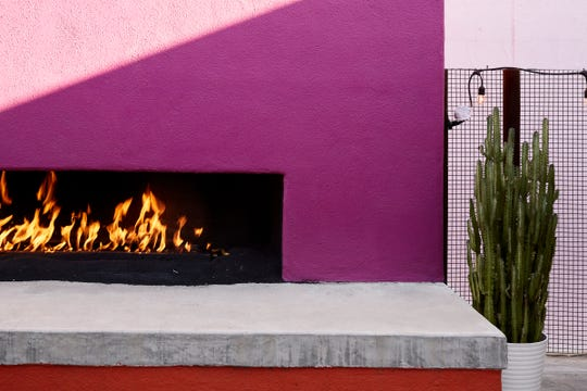 An outdoor fireplace at La Señora, inside Saguaro Scottsdale.