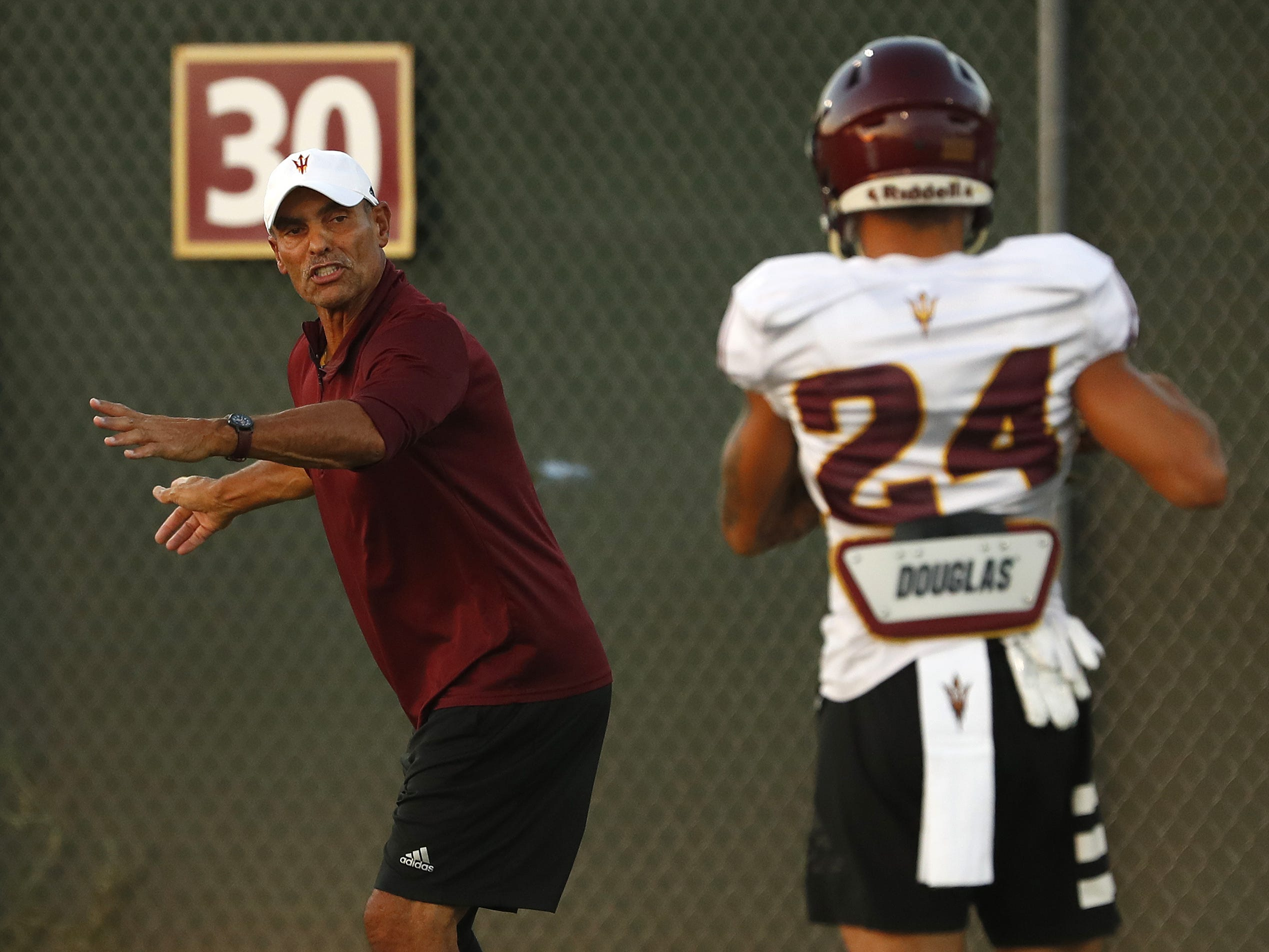 ASU's head coach Herm Edwards instructs players during a practice at Kajikawa Football Practice Fields in Tempe, Ariz. on Aug. 6, 2018.