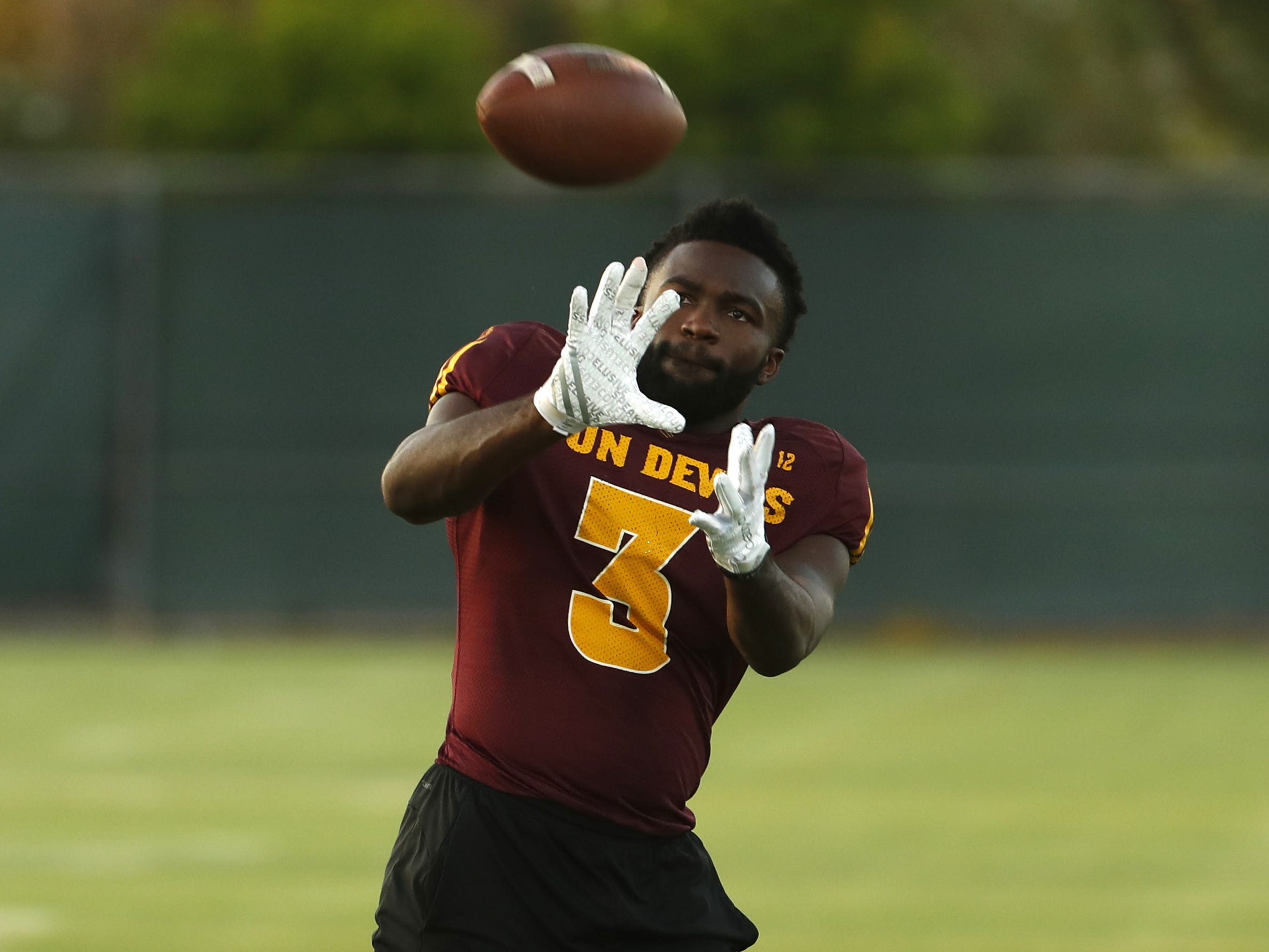 ASU's Eno Benjamin (3) catches a pass during a practice at Kajikawa Football Practice Fields in Tempe, Ariz. on Aug. 6, 2018.