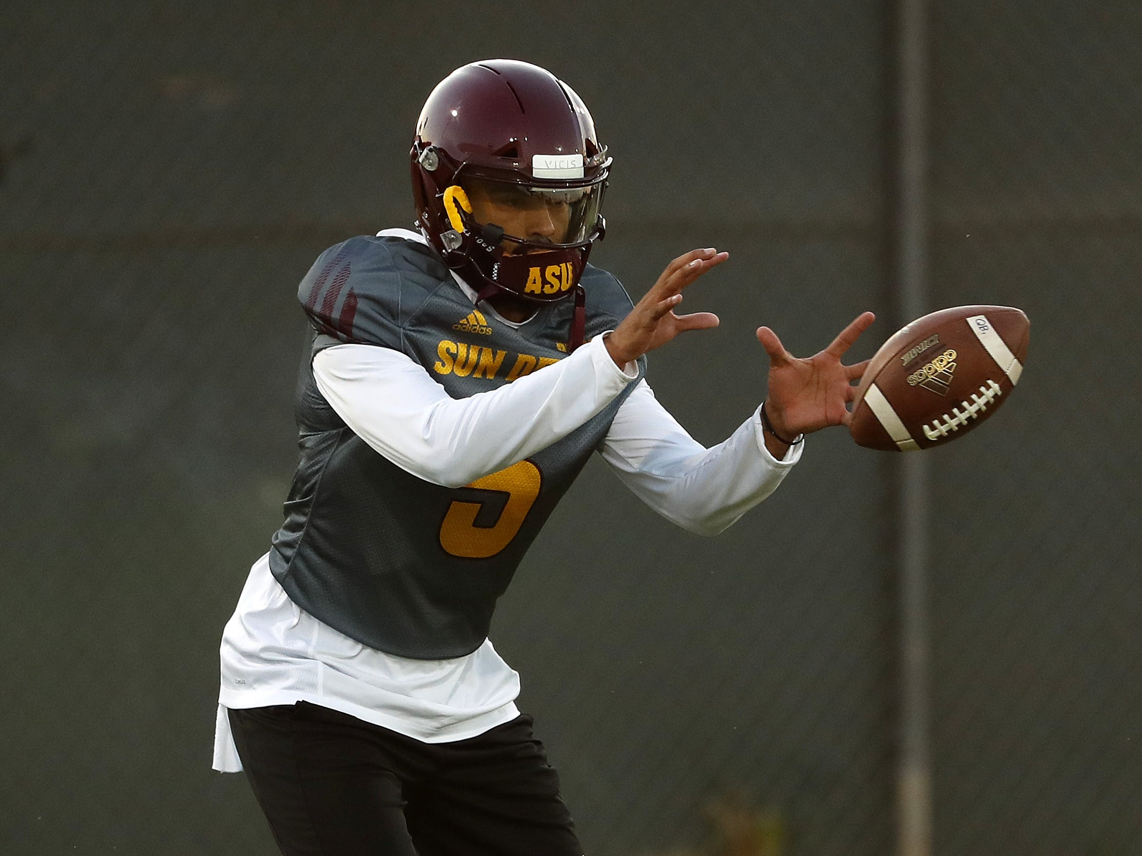 ASU's Manny Wilkins (5) catches a snap during a practice at Kajikawa Football Practice Fields in Tempe, Ariz. on Aug. 6, 2018.