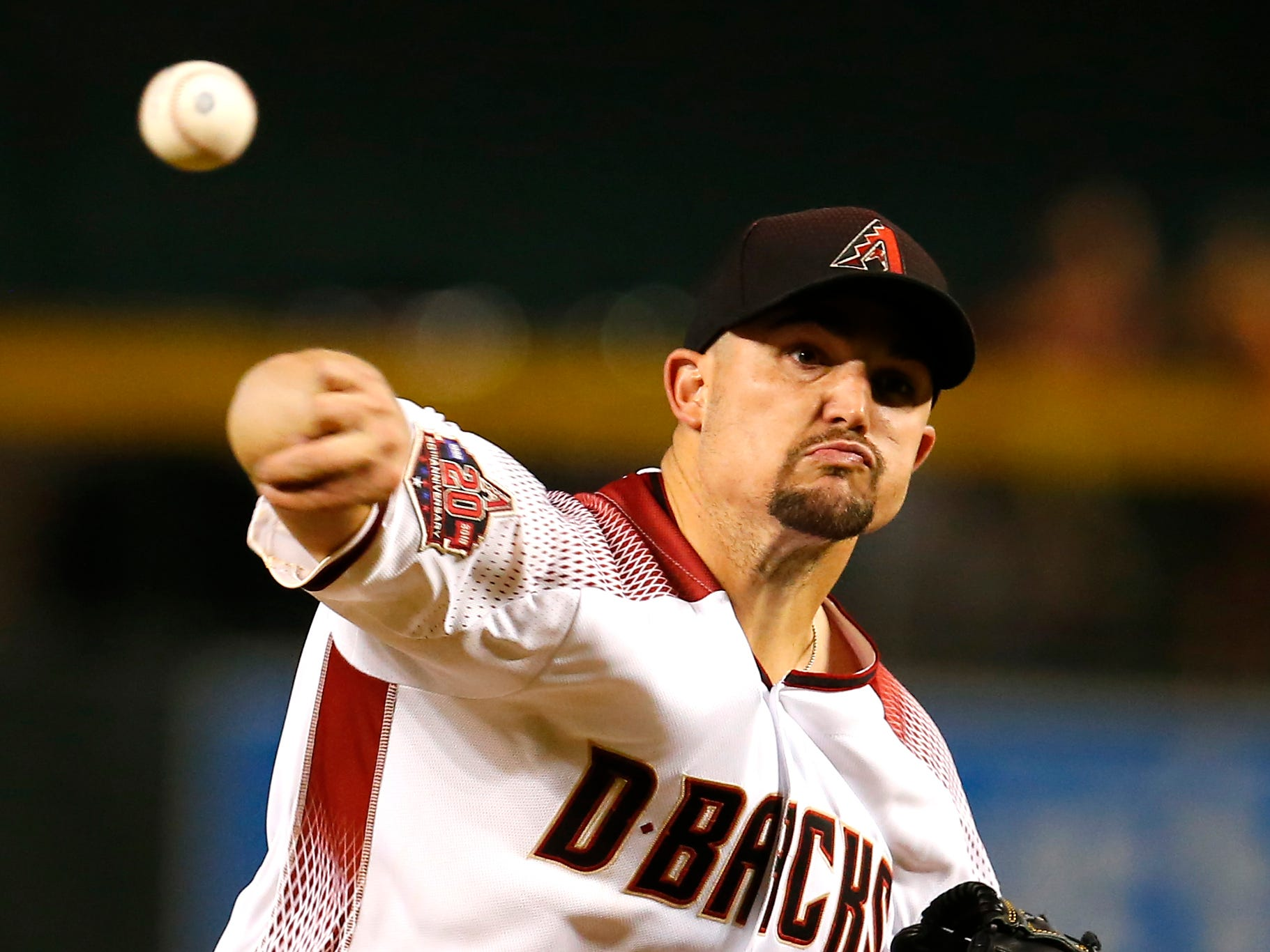 Arizona Diamondbacks starting pitcher Zack Godley (52) in the first inning during a baseball game against the Philadelphia Phillies, Monday, Aug. 6, 2018, in Phoenix.