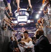 Phoenix Suns guard Devin Booker (1) has quickly become a star in Arizona.