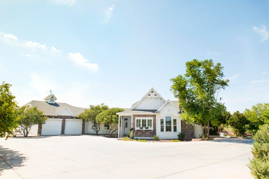 The Modern farmhouse Sutton Farms its on 1.25 acres of land in Gilbert.