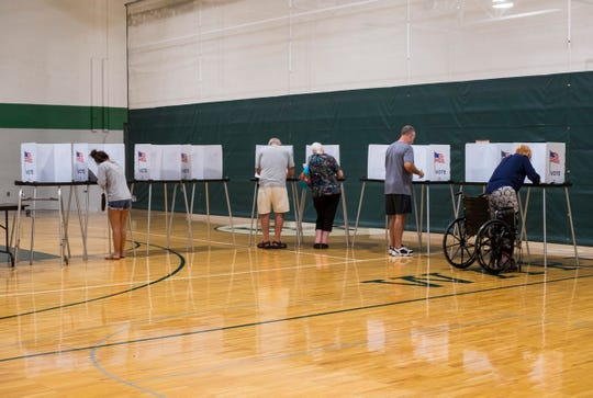 Port Huron residents cast their votes Tuesday, Aug. 7, 2018, in the August primary elections at Holland Woods Middle School in Port Huron. Polls will remain open until 8 p.m. Tuesday night.