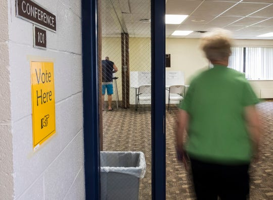 A voter heads into the Precinct 4 polling station to vote in the Michigan primary elections Tuesday, Aug. 7, 2018, at the Palmer Park Recreation Center in Port Huron.