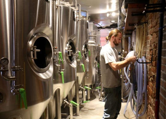 Cortlandt Toczylowski logs information about the current batch of beer in production at Kings Court Brewing in the City of Poughkeepsie on August 7, 2018.
