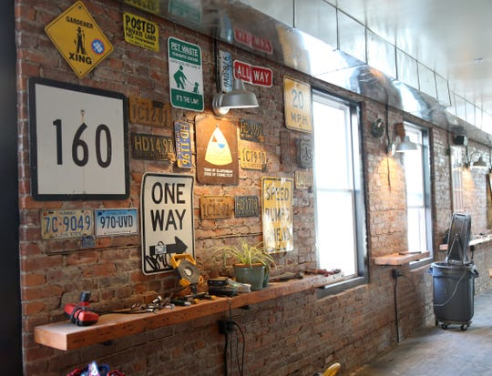 Vintage signs decorate a wall at Kings Court Brewing in the City of Poughkeepsie.