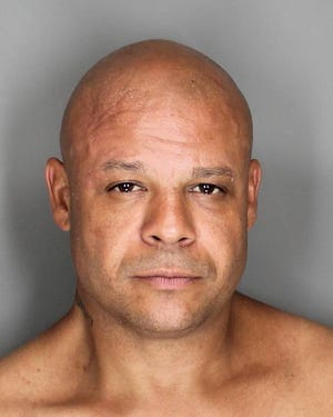 Howard Hill, 41, faces a felony charge after town police said he robbed a 79-year-old woman of her pocketbook.