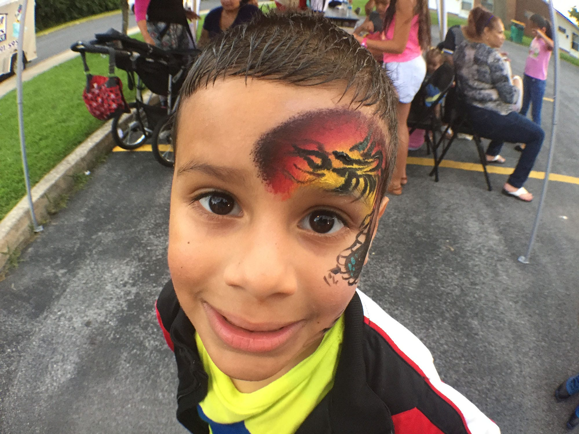 Esteban Perez-Acevedo, 5, shows off his face art during an event. Chambersburg Police Department National Night Out was held Tuesday, August 7, 2018 at the Franklin County Housing Authority complex. The annual event is designed to have community members get a chance to meet first responders.