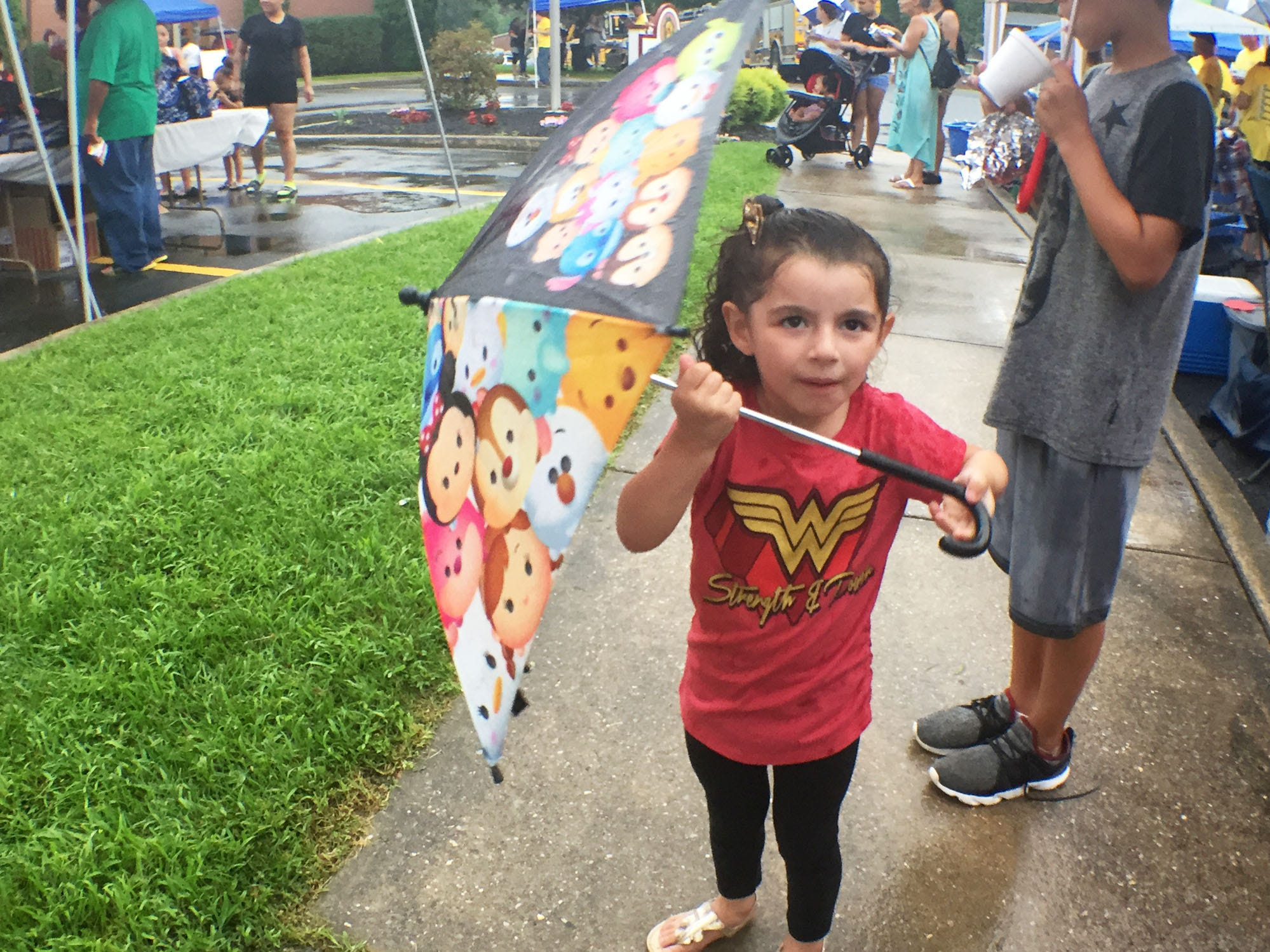 Leilany Acevedo, 3, twirls her umbrella in the rain while enjoying the festivities. Chambersburg Police Department National Night Out was held Tuesday, August 7, 2018 at the Franklin County Housing Authority complex. The annual event is designed to have community members get a chance to meet first responders.