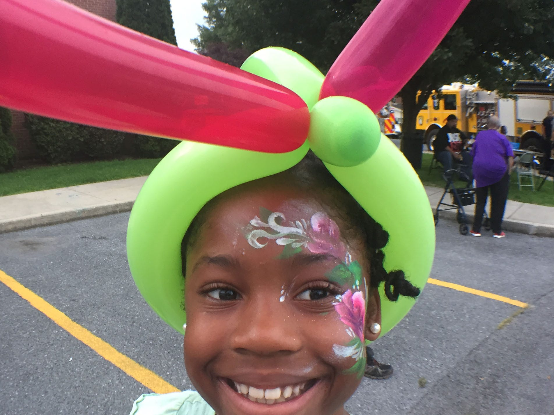 LaNayah Marshall, 9, wears a smile, a balloon hat and face paint during an event. Chambersburg Police Department National Night Out was held Tuesday, August 7, 2018 at the Franklin County Housing Authority complex. The annual event is designed to have community members get a chance to meet first responders.