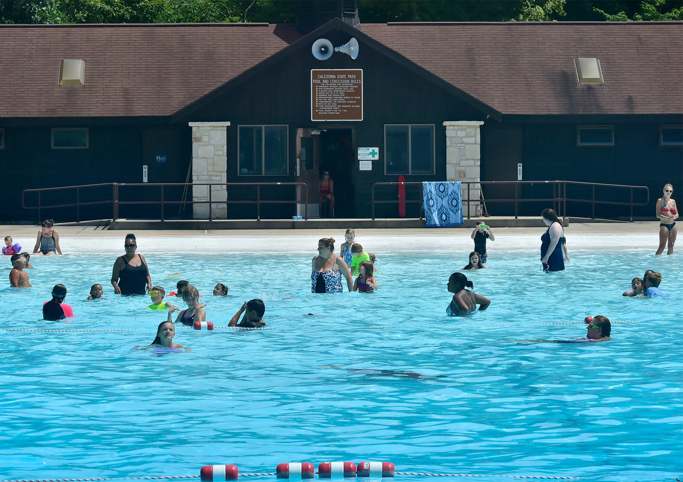 Patrons enjoy a warm day at Caledonia State Park pool, 101 Pine Grove Road, on Tuesday, August 7, 2018. A swimmer recently drowned at the Fayetteville area pool.