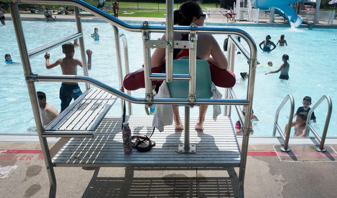 Lifeguards watch patrons at Caledonia State Park pool on Tuesday, August 7, 2018. A swimmer recently drowned at the Fayetteville area pool.