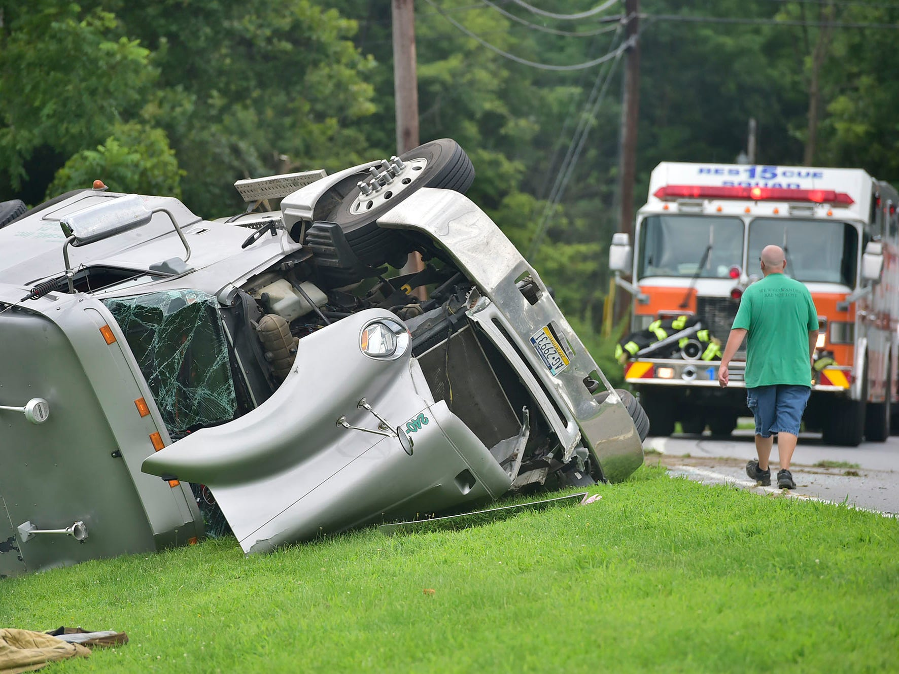 A tractor-trailer, hauling liquid tar, overturned across from 456 Siloam Road, Greene Township, just before 12:30pm, today. The driver was not injured in the crash. The street is closed at Airport Road as state police investigate. Firefighters are trying to contain the flow of oil and keep it out of the nearby creek.