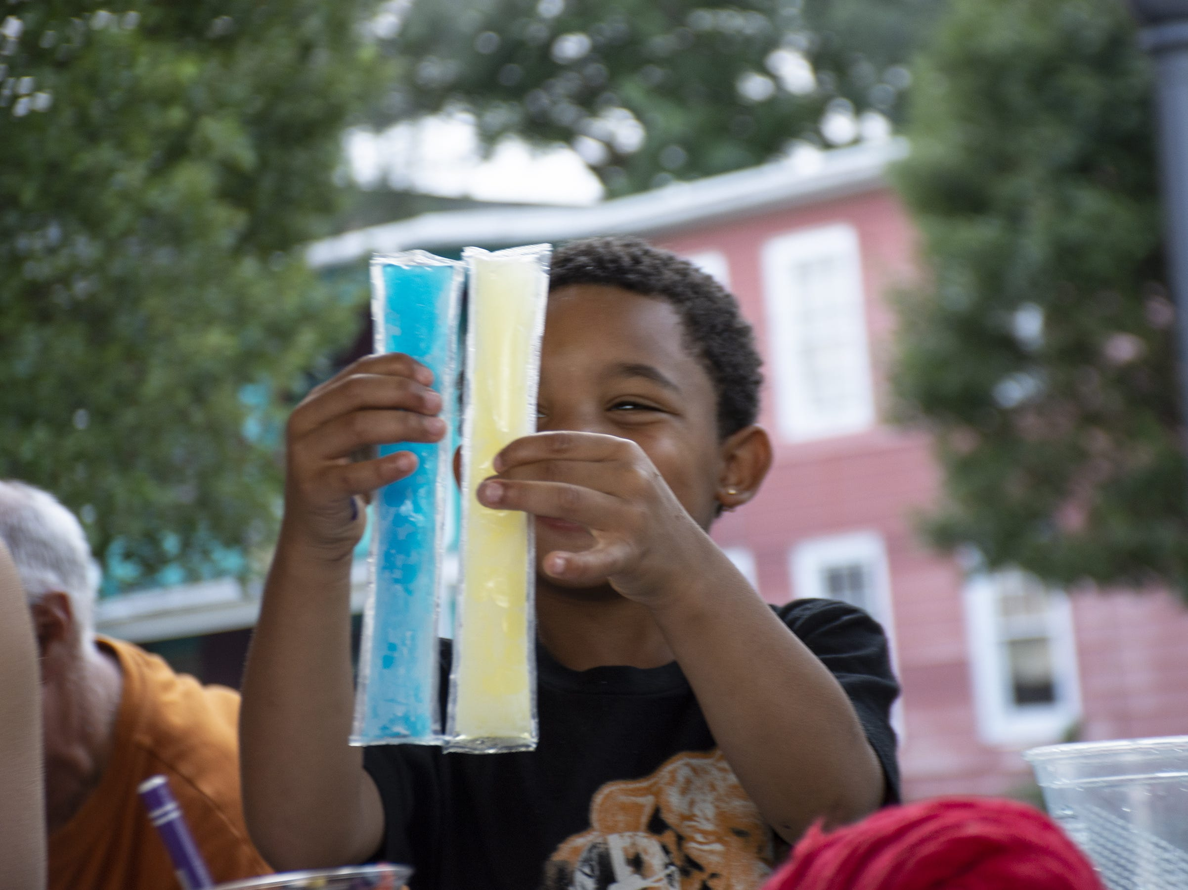 Jahlil Brown, 5, enjoys two popsicles at Art in the Parks at Renaissance Park in York.
