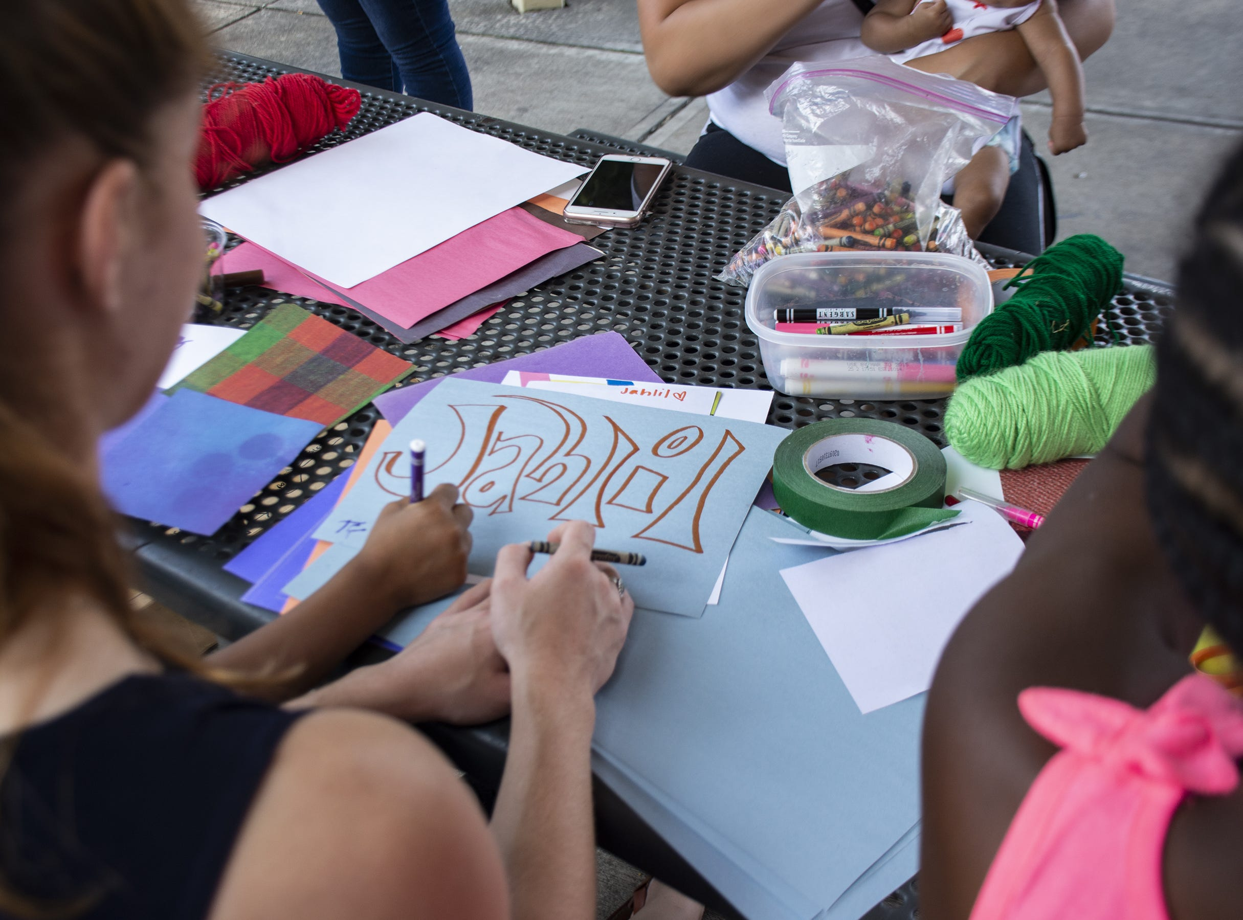 Kids draw during Art in the Parks in York on Monday.