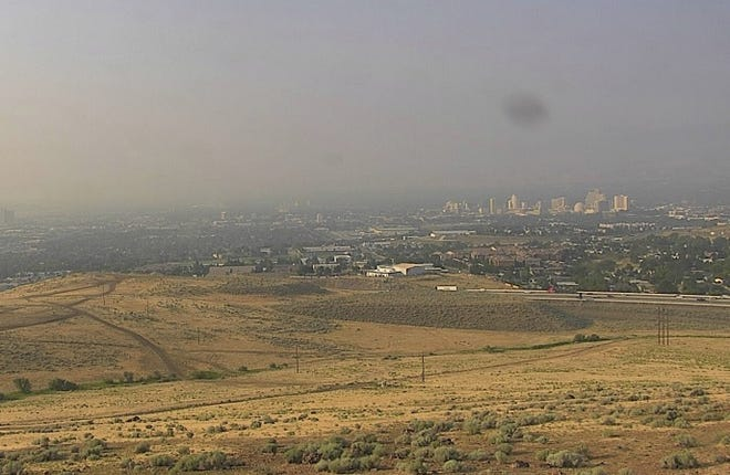 Smoke lingers over Reno on Tuesday, Aug. 7, 2018 as winds bring in the haze from California wildfires.