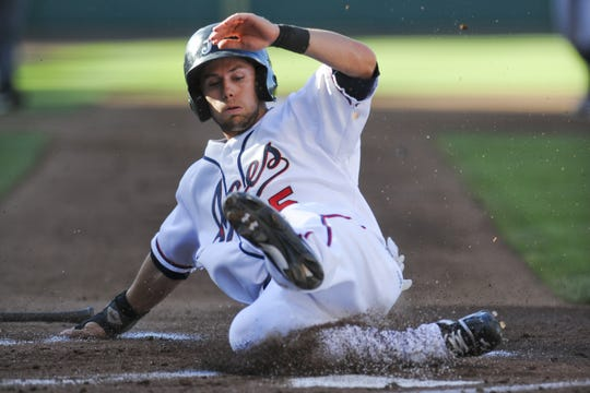 Chris Owings slides into home as he scores the first run of the night during the Triple-A All-Star Game at Aces Ballpark in 2013.