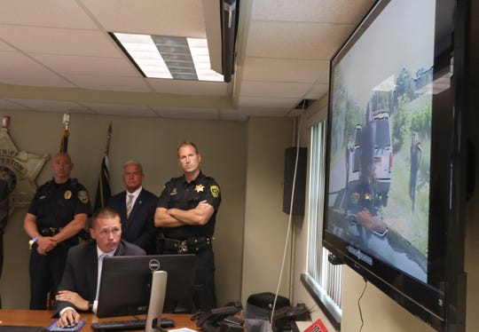 Livingston County Sheriff's Investigator Josh Monster, seated, plays the dash cam video of the encounter between Geneseo Police and fugitive David Clyde Morgan during their media briefing at the Livingston County Sheriff's Office in Geneseo Tuesday, Aug. 7, 2018.