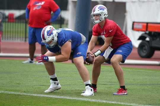 Quarterback Josh Allen takes a snap from center Russell Bodine.