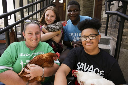 Some members of the chicken club at World of Inquiry include Jules Wagner, top left, Kasim O'Meally, top right, Kian Acevedo, bottom right and Jennifer Wagner bottom left.