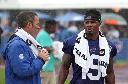 Bills GM Brandon Beane, shown here greeting receiver Corey Coleman to the team after a trade with Cleveland, is bullish on Bills continuing to hold training camp in Rochester.