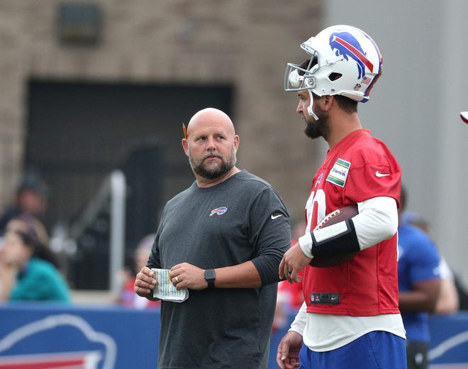 Bills offensive coordinator  with quarterback AJ McCarron during training camp.  McCarron will likely start the opening preseason game against Carolina.