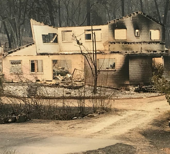 This two-story building in the Shasta area, like many homes, was gutted by the Carr Fire.