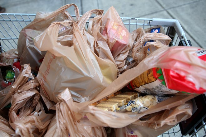A customer uses plastic bags at the Fred Meyer store on Commercial Street SE in Salem this month.