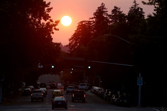 Smoke from wildfires in Southern Oregon and California creates a hazy sunset in Salem on Monday, Aug. 6, 2018.