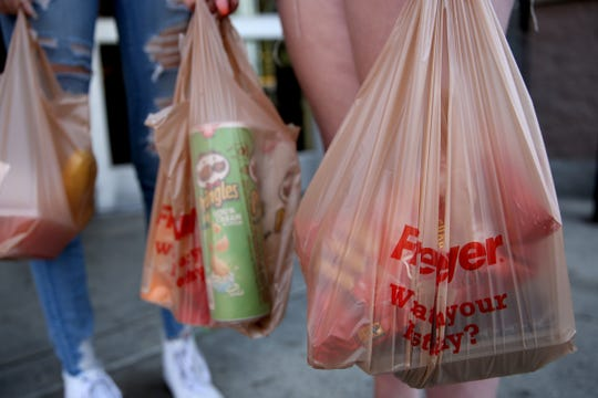 Customers use plastic bags at the Fred Meyer on Commercial St. SE in Salem.