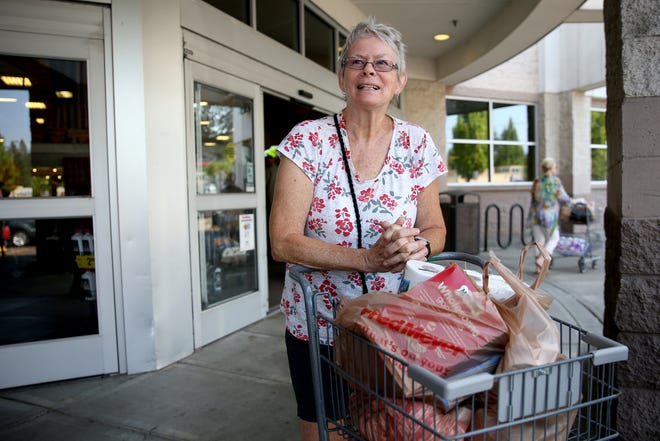 Barbara Holland, 71, of Salem, uses plastic bags at the Fred Meyer on Commercial St. SE in Salem on Tuesday, Aug. 7, 2018.