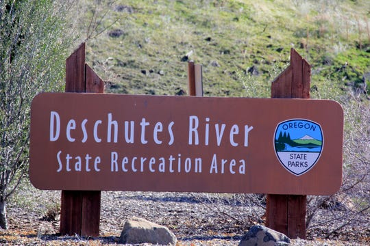 The trailhead announces the Deschutes River State Recreation Area The lower Deschutes River Trail follows an old railroad bed into the Eastern Oregon canyon.