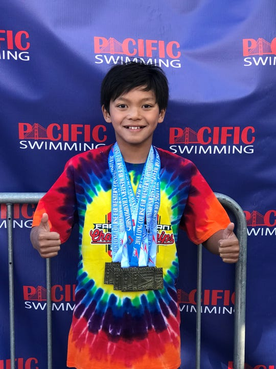 Salinas native Clark Kent Apuada set three new personal bests last weekend in the Pacific Coast 14 and under Junior Olympics in Walnut Creek and won his age group.