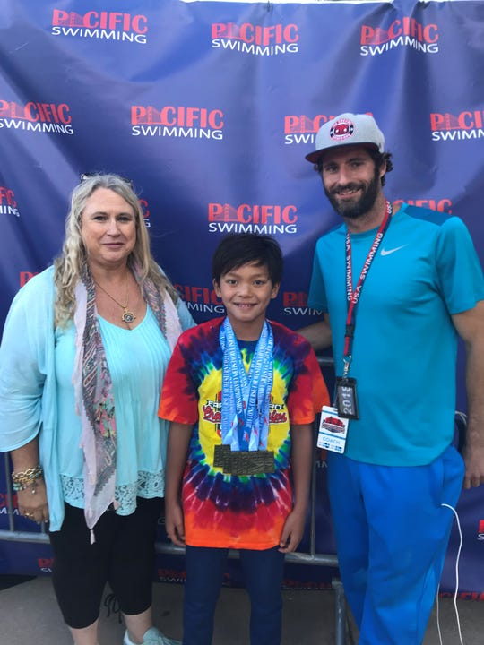 Apuada's main coaches at the Salinas Aquatic Center, Dia Rianda (left) and her son Travis (right), have been working with him since he was three years old. He progressed through six levels of Swim America lessons in four years before joining the Monterey County Aquatic Team at age seven.