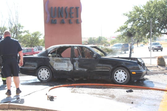 Car catches fire on Aug. 7, 2018 at Sunset Mall.