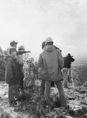 Local Sierra Club members view the terrain from Mount Susan during a hike in Pugh Park to protest the site as a candidate for a powerful radar system.