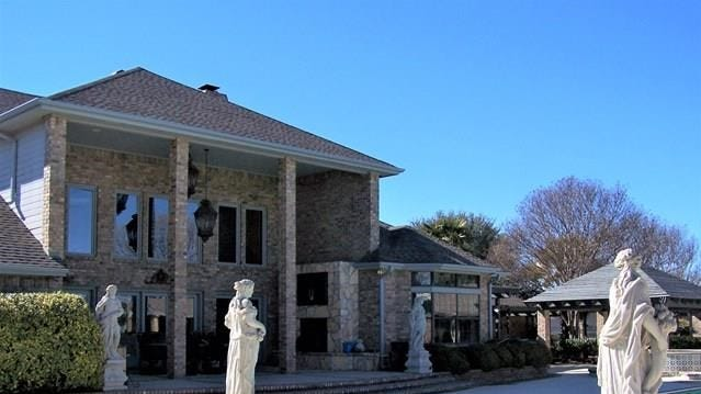 The main view of the property includes the custom made limestone statues. The statues were built in Garden City, Texas.