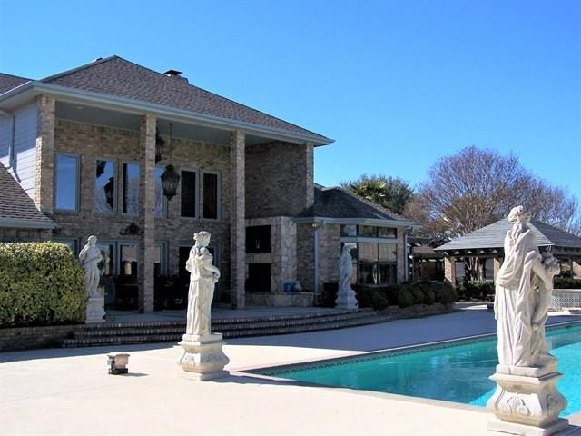 This home at 1512 Darlene St. in San Angelo includes custom-made limestone statues created in Garden City, Texas.
