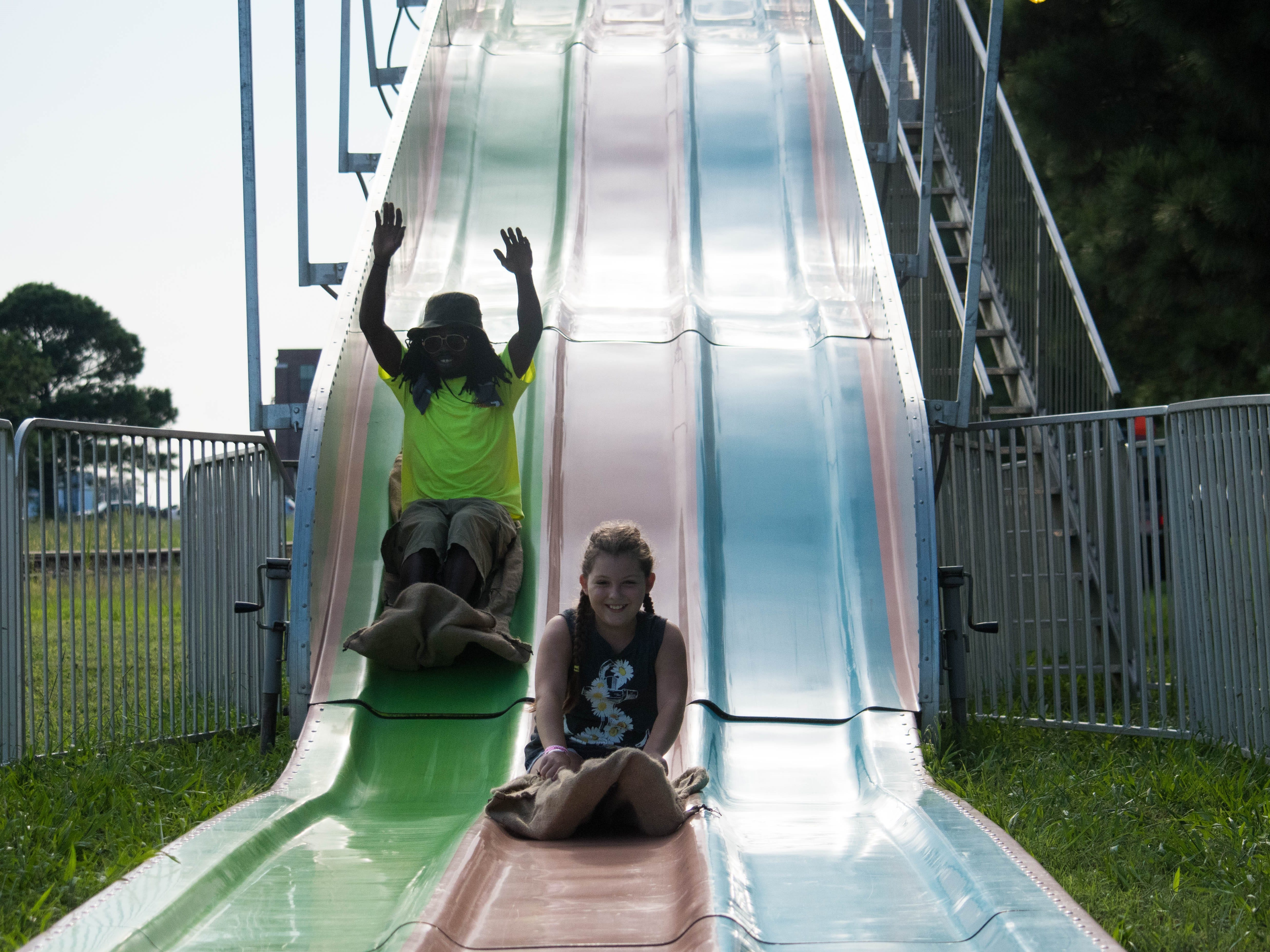 Volunteer Gerard Williams and   Shelby Blankenship test out a slide during the Cape Charles Volunteer Fire Company Carnival on Sunday, Aug. 5.